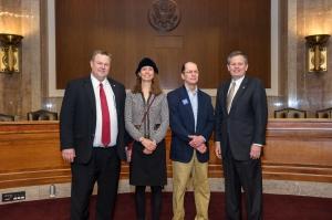 Montana Senator Jon Tester, Lori Byron, Robert Byron, and Senator Steve Daines